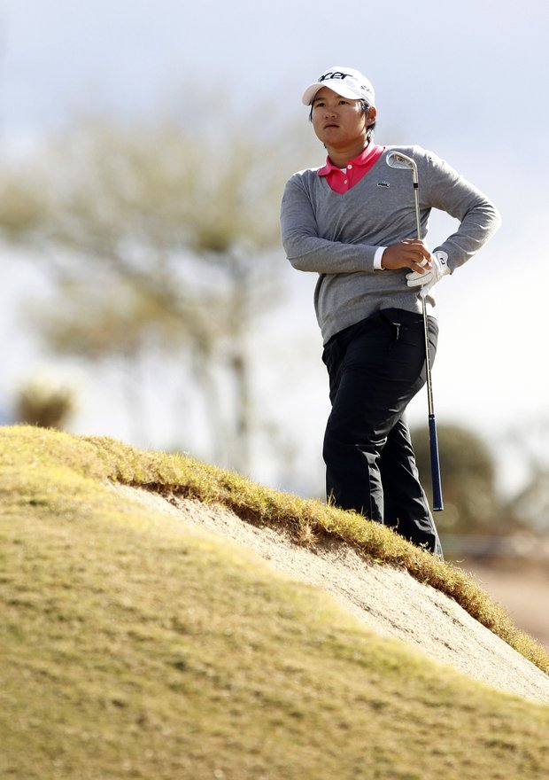 Yani Tseng, of Taiwan, watches her approach shot land on the 11th green during the final round of the LPGA Founders Cup golf tournament Sunday, March 18, 2012, in Phoenix.