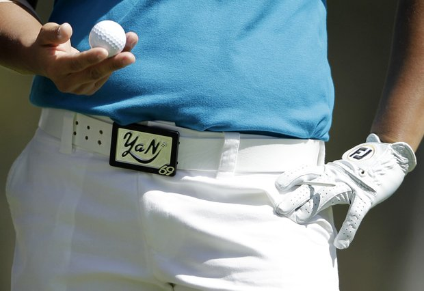 Yani Tseng, of Taiwan, holds a golf ball as she wears a buckle with her name on it during the second round of the Kia Classic LPGA golf tournament, Friday, March 23, 2012, in Carlsbad, Calif.