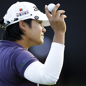 Yani Tseng, of Taiwan, reacts to the crowd after finishing on the 18th hole during the third round of the Kia Classic LPGA golf tournament, Saturday, March 24, 2012, in Carlsbad, Calif.