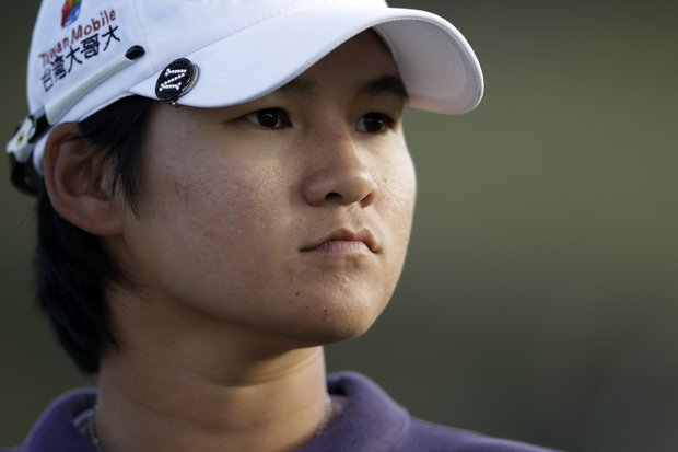 Yani Tseng, from Taiwan, watches on the 18th hole during the third round of the Kia Classic LPGA golf tournament Saturday, March 24, 2012, in Carlsbad, Calif.