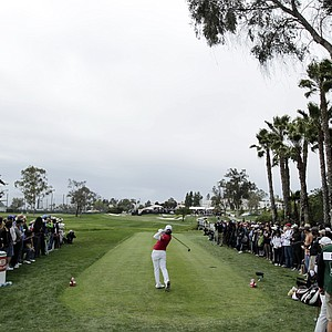 Yani Tseng, center, of Taiwan, hits her tee shot on the 18th hole during the final round of the Kia Classic LPGA golf tournament on Sunday, March 25, 2012, in Carlsbad, Calif.