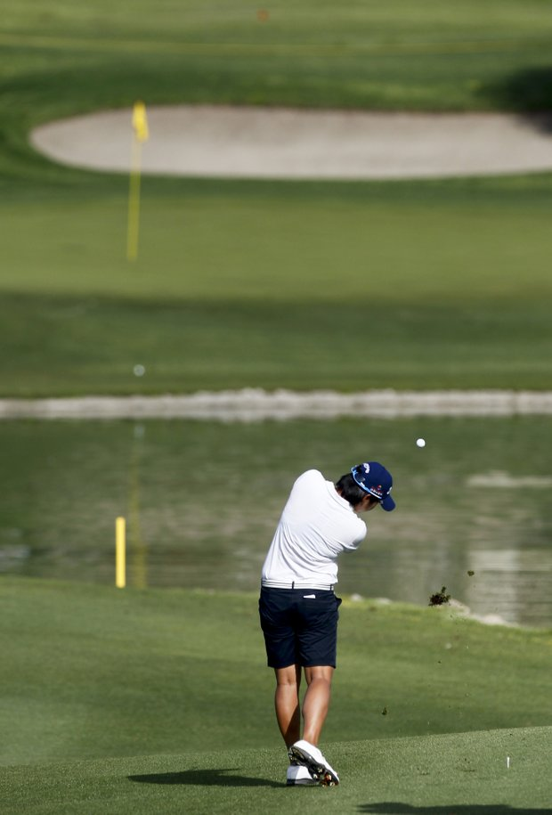 Yani Tseng, of Taiwan, hits to the sixth green during the pro-am round of the LPGA Kraft Nabisco Championship golf tournament in Rancho Mirage, Calif., Wednesday, March 28, 2012.