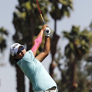 Yani Tseng, of Taiwan, watches her tee shot on the third hole during the third round of the LPGA Kraft Nabisco Championship golf tournament in Rancho Mirage, Calif., Saturday, March 31, 2012.