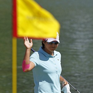Yani Tseng, of Taiwan, waves after a good bunker shot on the sixth hole during the third round of the LPGA Kraft Nabisco Championship golf tournament in Rancho Mirage, Calif., Saturday, March 31, 2012.