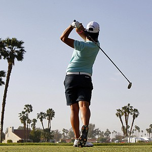 Yani Tseng, of Taiwan, hits from the 18th tee during the third round of the Kraft Nabisco Championship golf tournament, Saturday, March 31, 2012, in Rancho Mirage, Calif.
