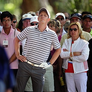 Luke Donald, of England, looks for a way out of the trees on the 15th fairway during the second round of the RBC Heritage golf tournament in Hilton Head Island, S.C., Friday, April 13, 2012.
