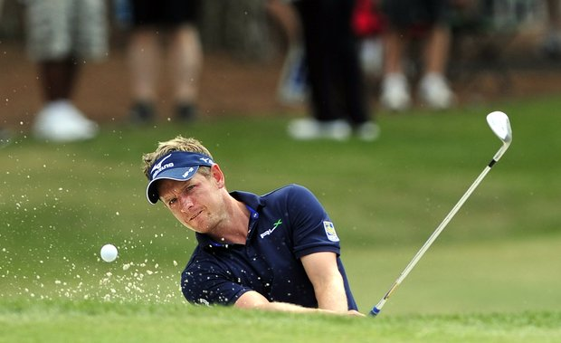 Luke Donald, of England, hits onto the ninth green from the bunker during the final round of the RBC Heritage golf tournament in Hilton Head Island, S.C., Sunday, April 15, 2012.