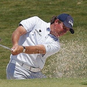 Phil Mickelson hits out of the bunker on the 15th hole of the final round of the PGA Byron Nelson Championship golf tournament, Sunday, May 20, 2012, in Irving, Texas. Mickelson finished the tournament with a four day total of 6-under, 274.