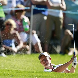 England's Luke Donald plays from bunker on the 15th hole during the third round of the PGA Championship at the Wentworth golf club, Virginia Water, England, Saturday May 26, 2012.