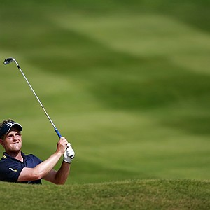 England's Luke Donald plays from a bunker on the 12th hole during the final round of the PGA Championship at the Wentworth golf club, Virginia Water, England, Sunday May 27, 2012.