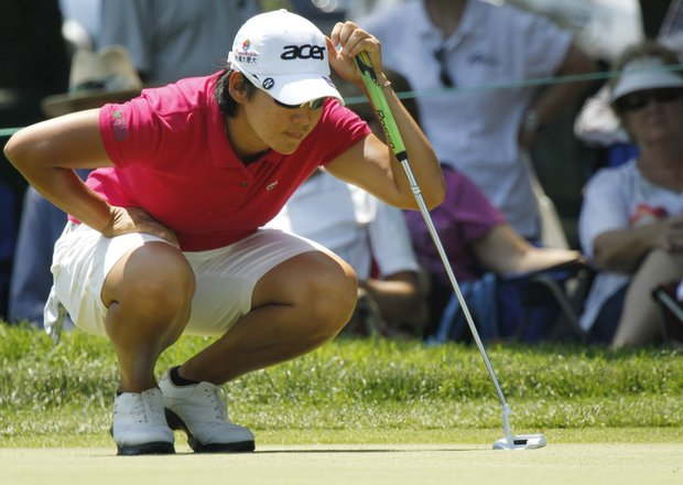 Yani Tseng, of Taiwan, lines up a putt on the ninth hole during the Wegmans LPGA Championship at Locust Hill Country Club in Pittsford, N.Y., Sunday, June 10, 2012.