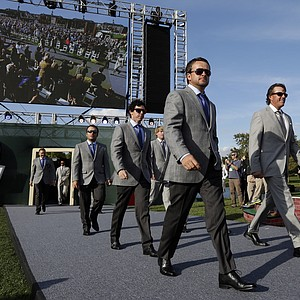 Europe's Graeme McDowell and USA's Phil Mickelson, right, are introduced during the opening ceremony at the Ryder Cup PGA golf tournament Thursday, Sept. 27, 2012, at the Medinah Country Club in Medinah, Ill.