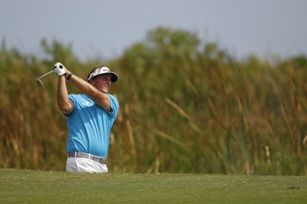 Phil Mickelson hits from the sand along the sixth hole during the first round of the PGA Championship golf tournament on the Ocean Course of the Kiawah Island Golf Resort in Kiawah Island, S.C., Thursday, Aug. 9, 2012.