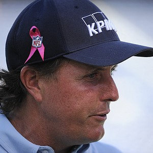 Golf professional Phil Mickelson wears a pink ribbon for Breast Cancer Awareness Month before an NFL football game between the Denver Broncos and the San Diego Chargers Monday, Oct. 15, 2012, in San Diego.