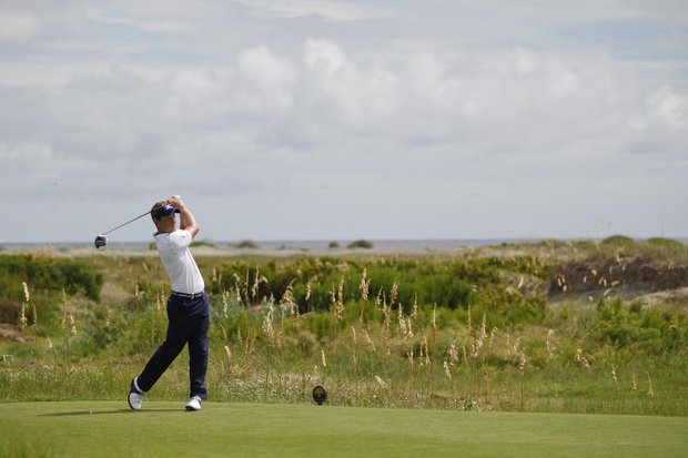 Luke Donald of England, watches his drive from the sixth tee during a practice round for the PGA Championship golf tournament on the Ocean Course of the Kiawah Island Golf Resort in Kiawah Island, S.C., Wednesday, Aug. 8, 2012.