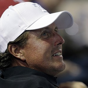 This May 16, 2012 file photo shows golfer Phil Mickelson watching a baseball game between the Oakland Athletics and Texas Rangers, in Arlington, Texas.