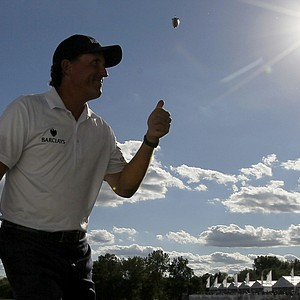 Phil Mickelson acknowledges the crowd with a thumbs-up after he birdied the 18th hole during the third round of the BMW Championship PGA golf tournament at Crooked Stick Golf Club in Carmel, Ind., Saturday, Sept. 8, 2012.