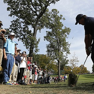 USA's Phil Mickelson hits out of the rough on the fourth hole at the Ryder Cup PGA golf tournament Tuesday, Sept. 25, 2012, at the Medinah Country Club in Medinah, Ill.