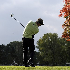 Europe's Luke Donald hits a drive on the ninth hole during a foursomes match at the Ryder Cup PGA golf tournament Friday, Sept. 28, 2012, at the Medinah Country Club in Medinah, Ill.