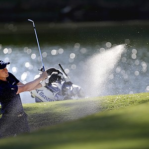 Luke Donald, of England, hits out of the sand trap on the 17th hole during the final round of the Tour Championship golf tournament Sunday, Sept. 23, 2012, in Atlanta.