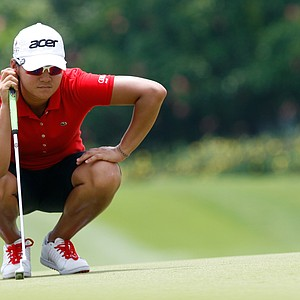 Yani Tseng of Taiwan lines up her putt on the 9th green during the first round of the LPGA Malaysia golf tournament at Kuala Lumpur Golf and Country Club in Kuala Lumpur, Malaysia, Thursday, Oct. 11, 2012.