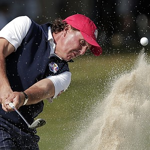 USA's Phil Mickelson hits out of a bunker on the sixth hole during a four-ball match at the Ryder Cup PGA golf tournament Friday, Sept. 28, 2012, at the Medinah Country Club in Medinah, Ill.