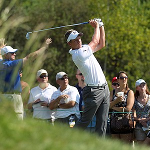 Luke Donald, from England, hits his tee shot on the third tee during the first round of the Deutsche Bank Championship golf tournament at TPC Boston in Norton, Mass., Friday, Aug. 31, 2012.