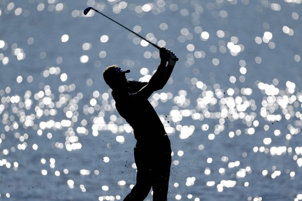 Luke Donald, of England, hits off the fairway on the 17th hole during the final round of the Tour Championship golf tournament, Sunday, Sept. 23, 2012, in Atlanta.