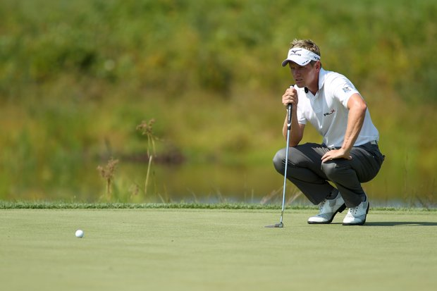 Luke Donald, from England, reads the green on the second hole during the first round of the Deutsche Bank Championship PGA golf tournament at TPC Boston in Norton, Mass., Friday, Aug. 31, 2012.
