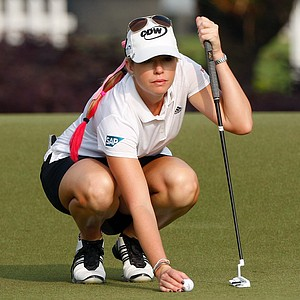 Paula Creamer of the United States lines up her putt on the 2nd green during the second round of the LPGA Malaysia golf tournament at Kuala Lumpur Golf and Country Club in Kuala Lumpur, Malaysia, Friday, Oct. 12, 2012.