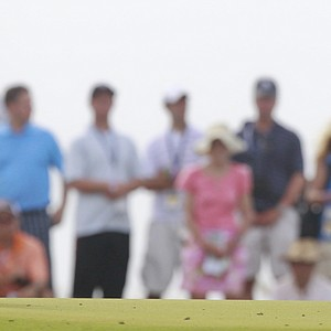 Luke Donald of England looks over his putt on the 14th green during the second round of the PGA Championship golf tournament on the Ocean Course of the Kiawah Island Golf Resort in Kiawah Island, S.C., Friday, Aug. 10, 2012.