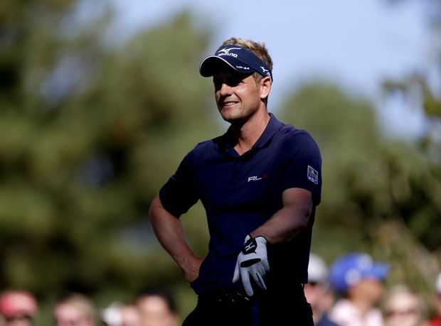 Luke Donald, of England, prepares to tee off on the 18th hole during the final round of the Tour Championship golf tournament Sunday, Sept. 23, 2012, in Atlanta.