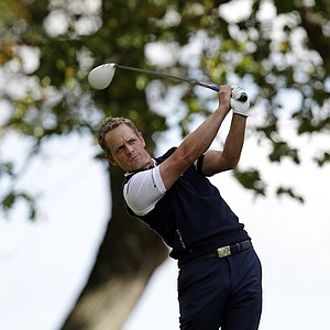 Europe's Luke Donald hits a drive on the third hole during a singles match at the Ryder Cup PGA golf tournament Sunday, Sept. 30, 2012, at the Medinah Country Club in Medinah, Ill.