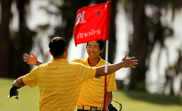 Cal's Michael Kim gets a hug from assistant coach Walter Chung after winning the Isleworth Collegiate Invitational.