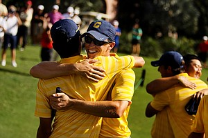 Cal's Brandon Hagy congratulates Michael Kim at the Isleworth Collegiate Invitational. Cal also won the event as a team.