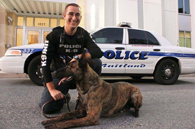 Maitland Police officer Taylor Stitt and K-9 officer Bosco outside the city's police complex.