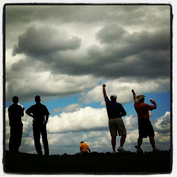 Spectators cheer as Cal's Michael Weaver chips in for eagle at No. 7 during the Isleworth Collegiate Invitational.