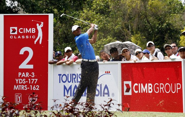 Tiger Woods tees off on the 2nd hole during Round 1 of the 2012 CIMB Classic in Kuala Lumpur, Malaysia.