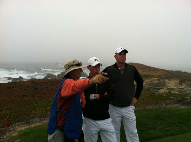 A caddie helps out two Duke players at Cypress Point for the Stanford Classic.