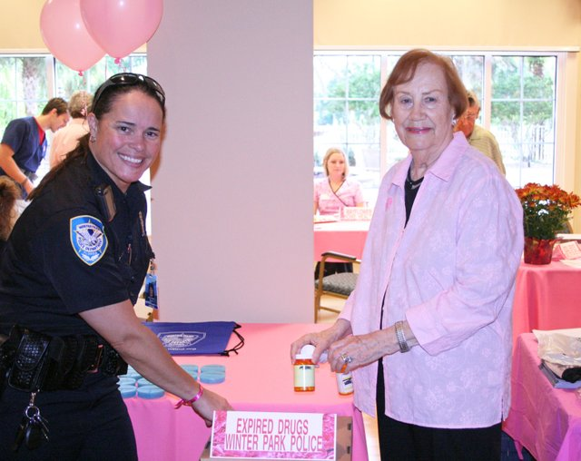 Winter Park Police Officer Lina Strube collects expired medications from Mayflower resident Carol Service.