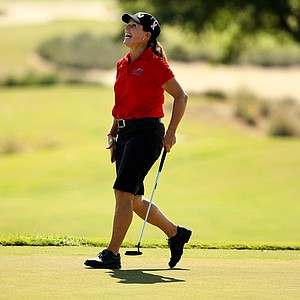 Lori Kane of Canada reacts to a putt at No. 18 during the morning matches during the ISPS Handa Cup at Reunion Resort. Kane won 4 events while on the LPGA tour.