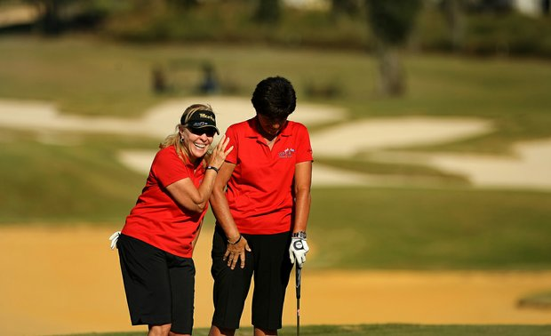 Jan Stephenson of Australia shares a laugh with her playing partner Anne Marie Palli of France during the ISPS Handa Cup at Reunion Resort. Stephenson won 16 times on LPGA and Palli won twice.