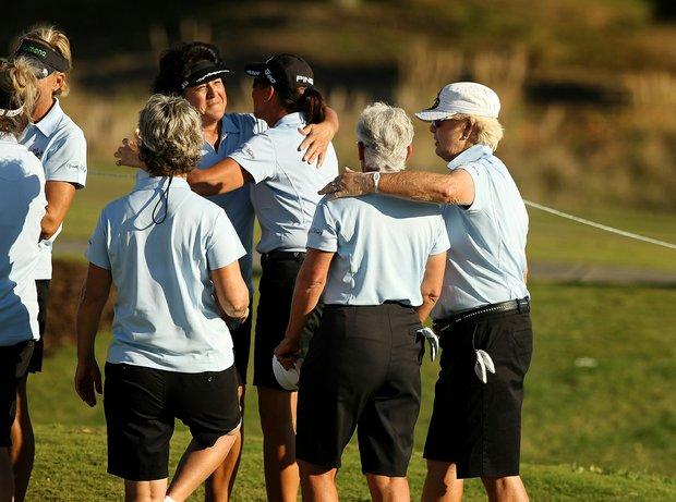 Pat Bradley, right, and Nancy Lopez, far left, congratulate team memers after day 1 of the ISPS Handa Cup at Reunion Resort.