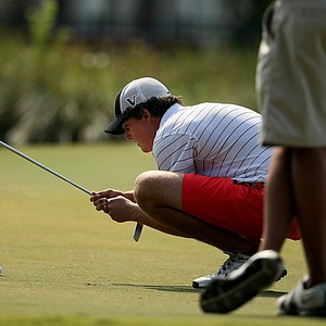Austen Truslow lines up his putt at the Golfweek East Coast Junior Invitational at Celebration Golf Club.