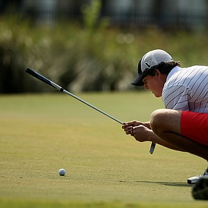Austen Truslow lines up his putt at the Golfweek East Coast Junior Invitational at Celebration Golf Club.