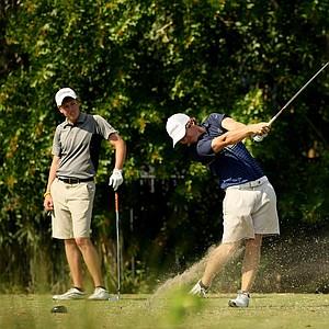Zachary Healy hits his tee shot at No. 13 as Will Long watches at the Golfweek East Coast Junior Invitational at Celebration Golf Club.