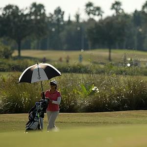 Cindy Feng, Cheyenne Knight and Simin Feng walk up No. 9 at the Golfweek East Coast Junior Invitational at Celebration Golf Club.