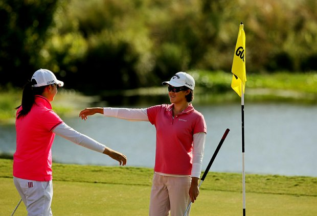 Cindy Feng, right, and Simin Feng (no relation) hug after their round at the Golfweek East Coast Junior Invitational at Celebration Golf Club.
