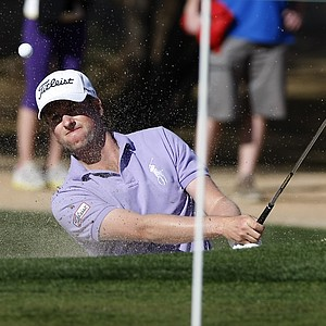 Webb Simpson hits out of the sand on the 12th hole during the final round of the Phoenix Open golf tournament on Sunday, Feb. 5, 2012, in Scottsdale, Ariz.