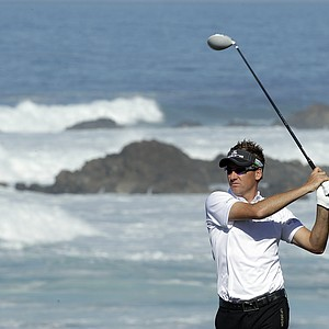 Ian Poulter hits off the 13th tee of the Monterey Peninsula course during the first round of the AT & T Pebble Beach National Pro-Am golf tournament Thursday, Feb. 9, 2012, in Pebble Beach, Calif.